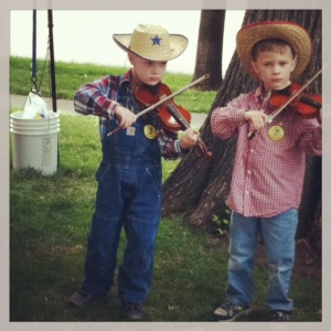 Darling little fiddlers at the farmer's market