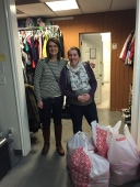 POP Operation Love Bundles Drop Off Day -Annie Peterson from Target standing next To Anna Stapley, Center Coordinator VOA Homeless Youth Resource Center